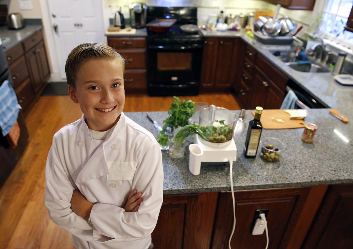 Still photo of Jake Nelson in chef attire in the kitchen